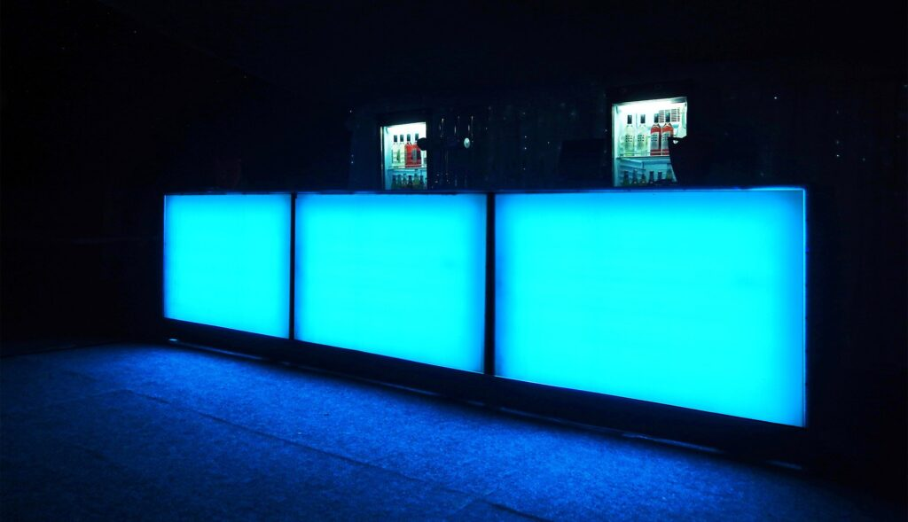 A party and events bar hire service set ups featuring our back-lit mobile bars